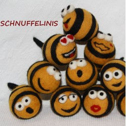Felt bees big and small