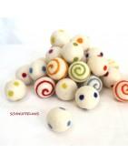 swirly felt balls, wool pom poms with swirly